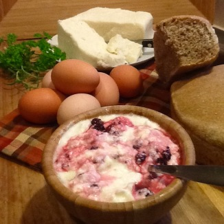 Blackberries from the woods in homemade yogurt, fresh mozzarella and farm fresh eggs..